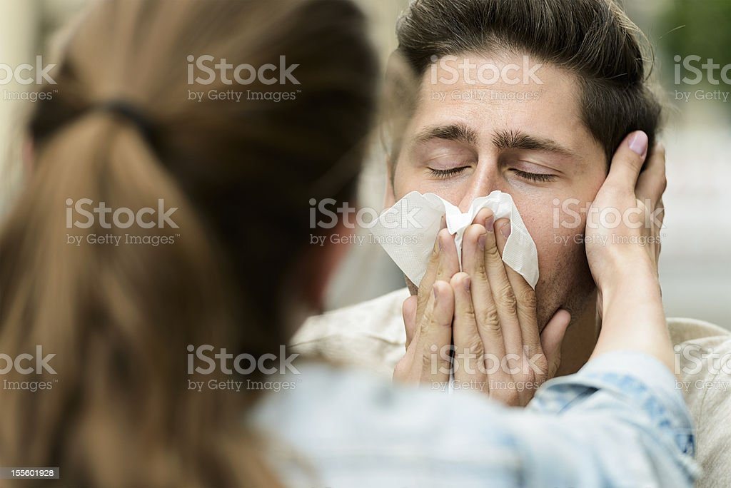 Consoling a Suffering Boyfriend stock photo