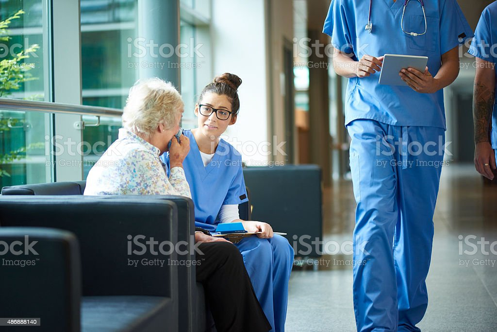 consoling a worried relative in the hospital stock photo