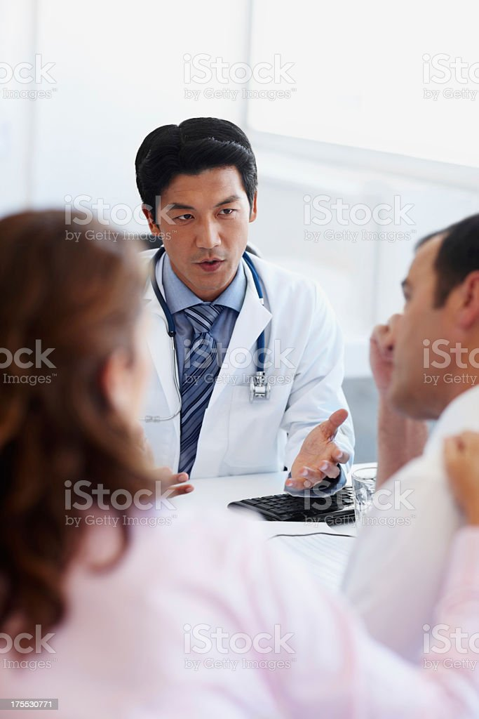 Consoling patients with his compassion stock photo