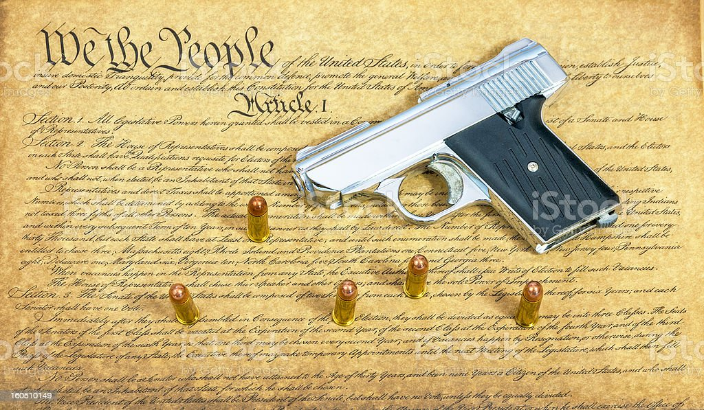 Constitution and handgun with bullets royalty-free stock photo
