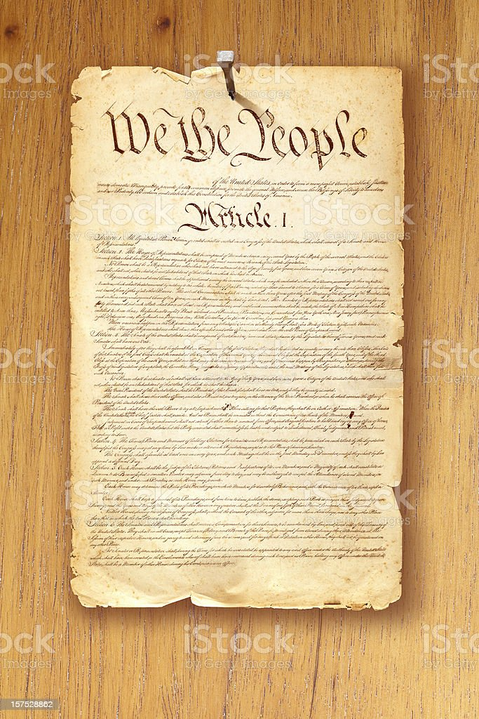 Constitution fixed with nail on wooden background royalty-free stock photo