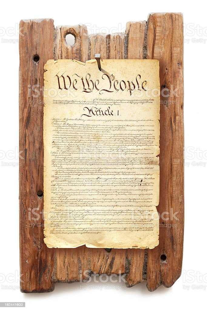 Constitution USA fixed with nail on wooden background royalty-free stock photo