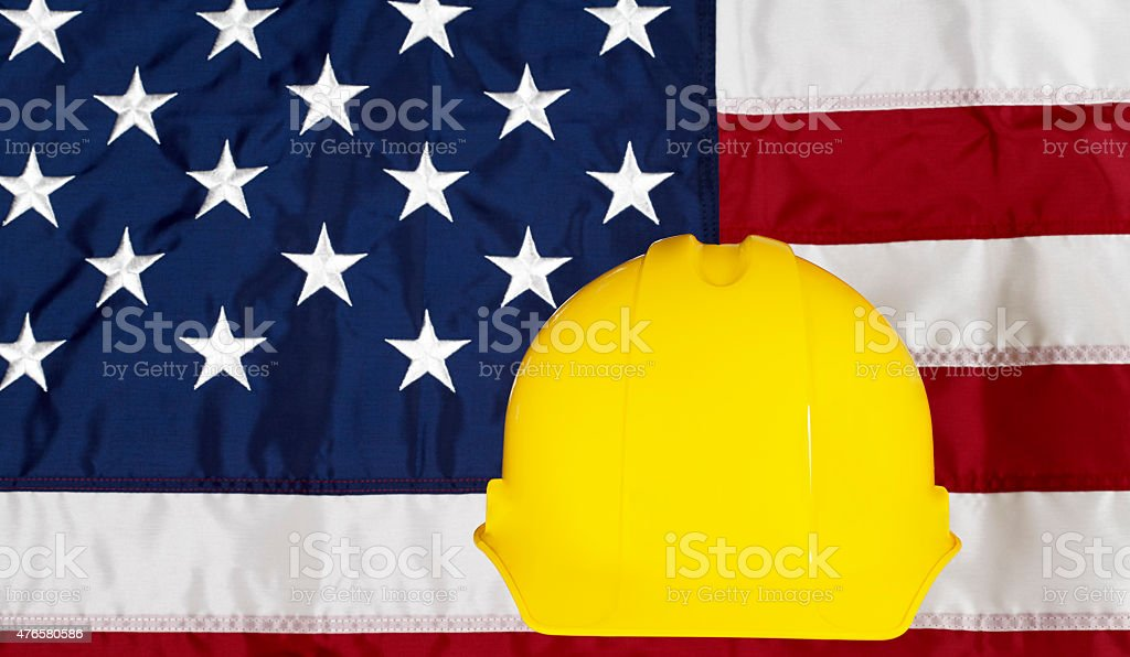 Construcion Industry Helmet on American Made Flag stock photo