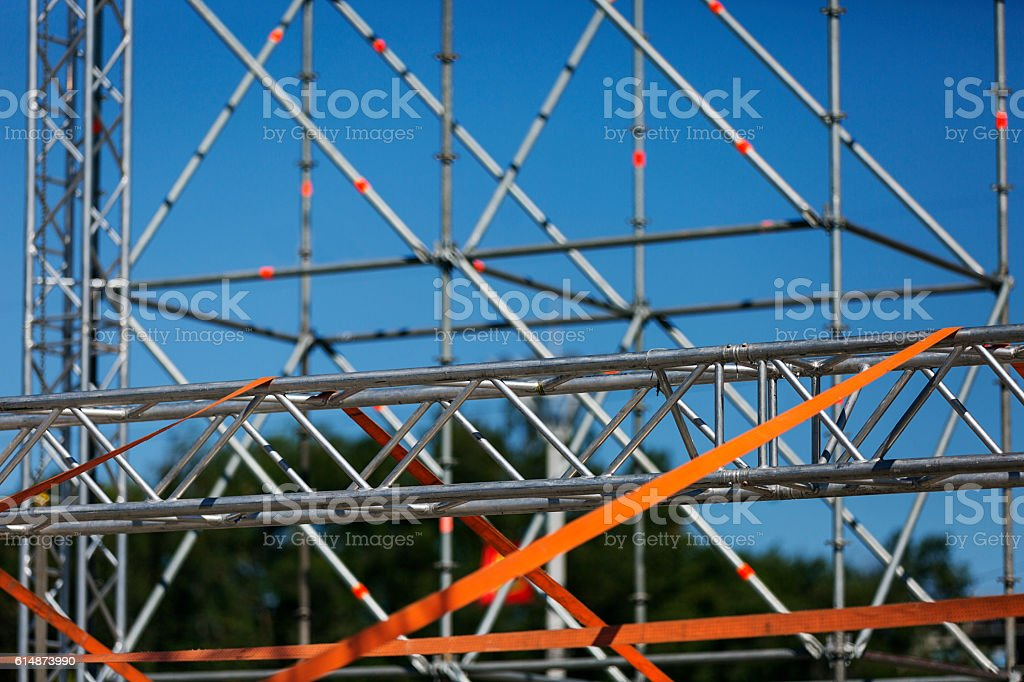 Constructing a new stage. Assembling frame of aluminium truss parts stock photo