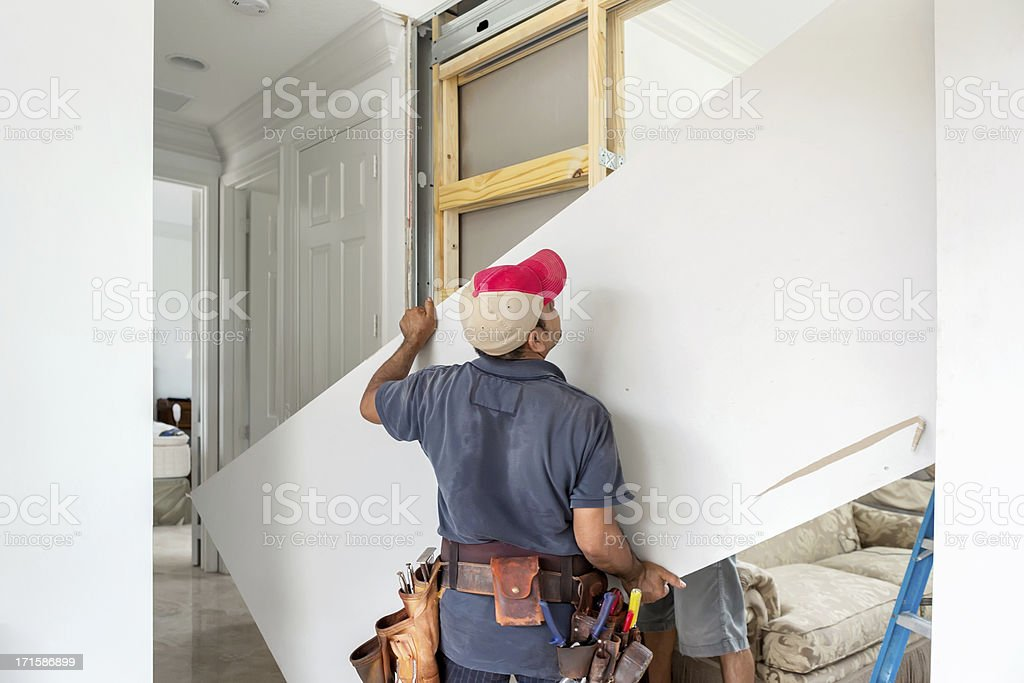 constructing an interior wall with drywall and  wood studs stock photo