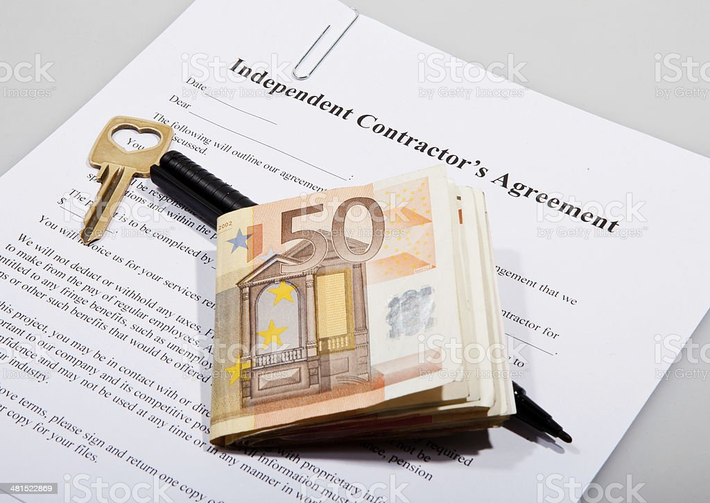 Construction agreement with key and Euro notes stock photo