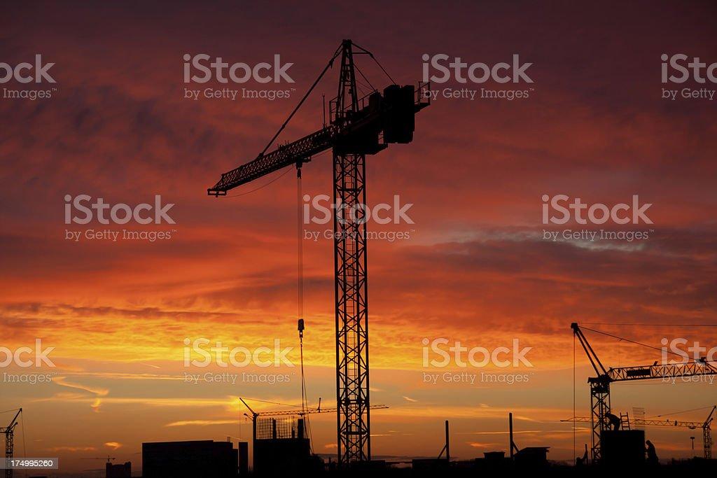 construction at sunrise royalty-free stock photo