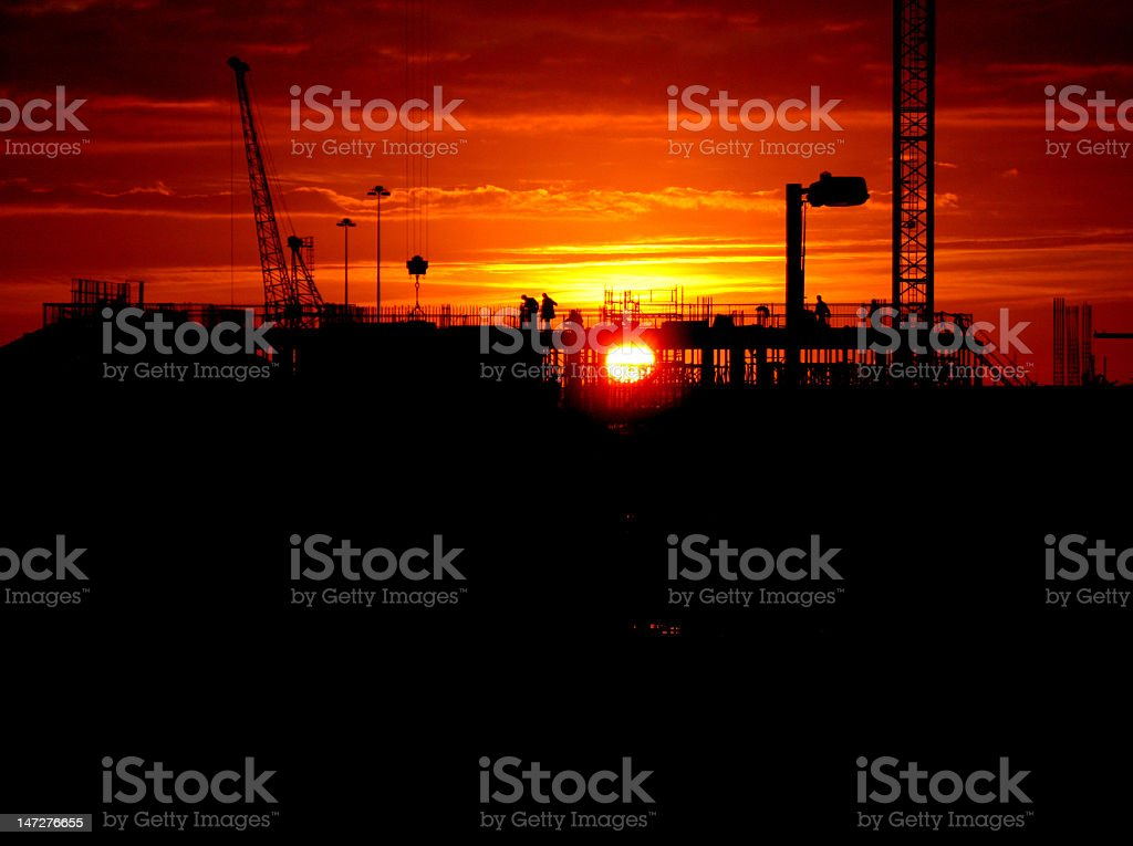 Construction at sunset royalty-free stock photo
