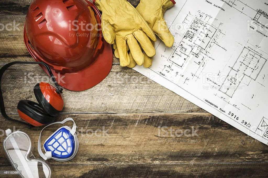 Construction blueprint with protective gear stock photo