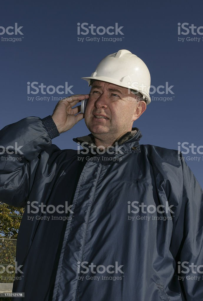 Construction Boss on Cell Phone royalty-free stock photo