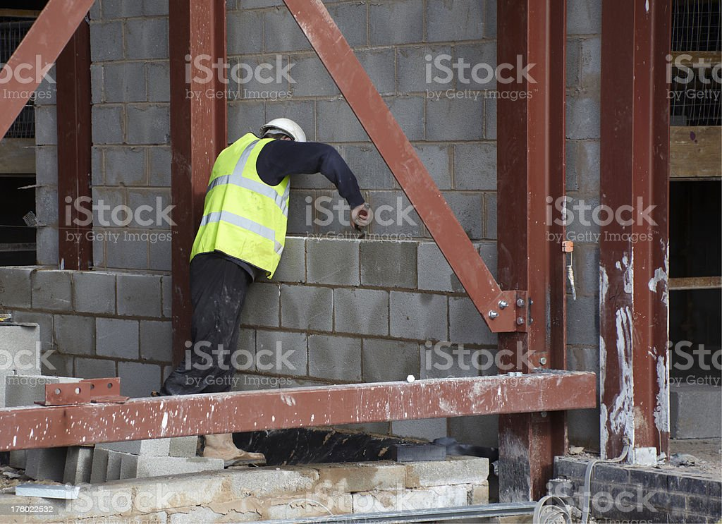 Construction bricklayer building wall from breezeblock royalty-free stock photo
