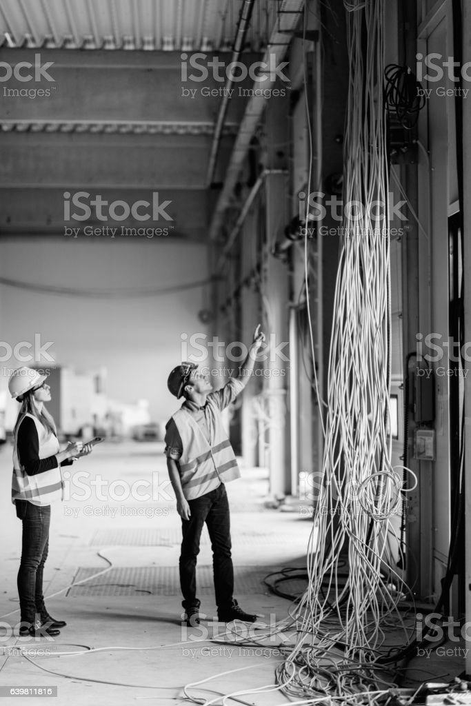 Construction building inspectors at work stock photo