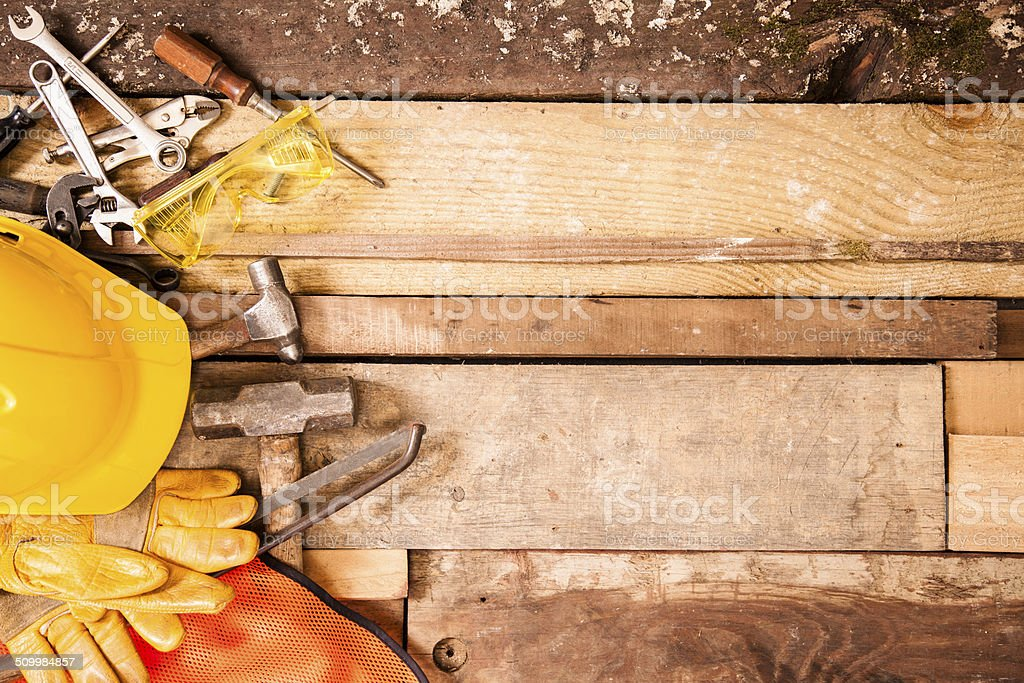 Construction, carpenter tools to left side. Old wooden boards background. stock photo