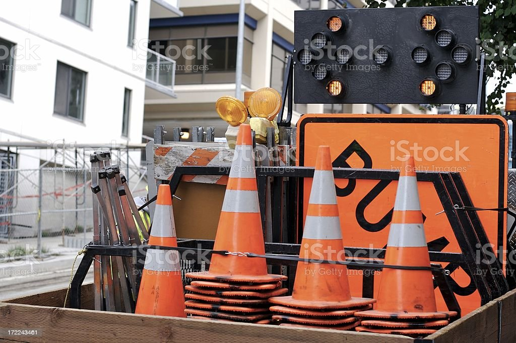 Construction cones and signs in back of truck stock photo