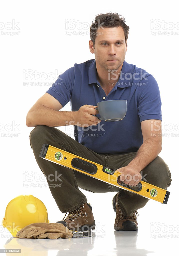 Construction Contractor Carpenter Kneeling With Hard Hat Coffee on White royalty-free stock photo