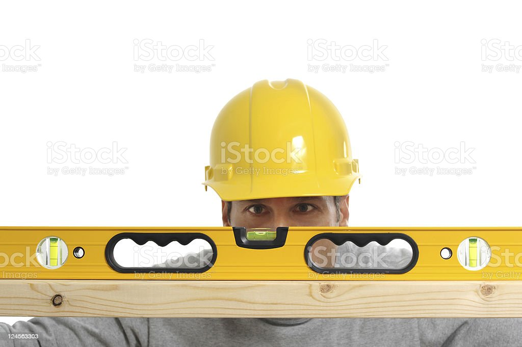 Construction Contractor Carpenter with Level and Hardhat on White royalty-free stock photo