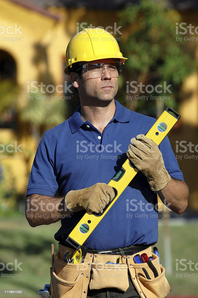 Construction Contractor Carpenter with Toolbelt Level Hard Hat royalty-free stock photo