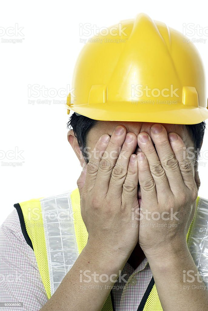 Construction contractor with remorse expression royalty-free stock photo
