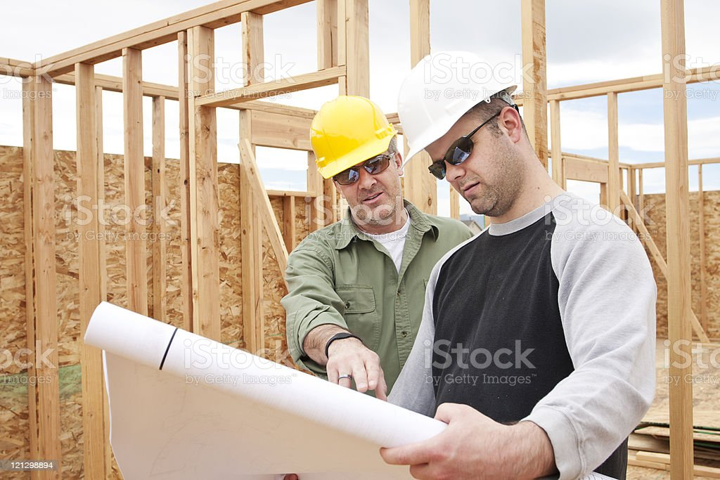 Construction Contractors building a new home royalty-free stock photo