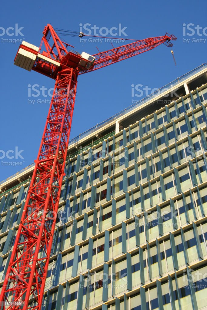 Construction Crane against Commercial Block royalty-free stock photo