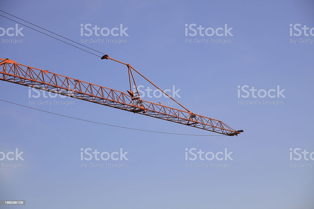 Construction crane against the blue sky royalty-free stock photo