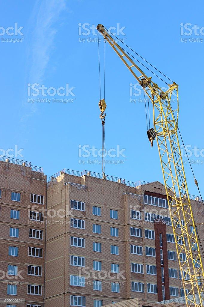 construction crane against the sky stock photo