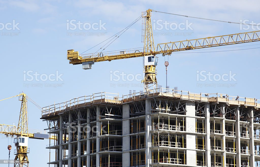Construction crane in operation stock photo