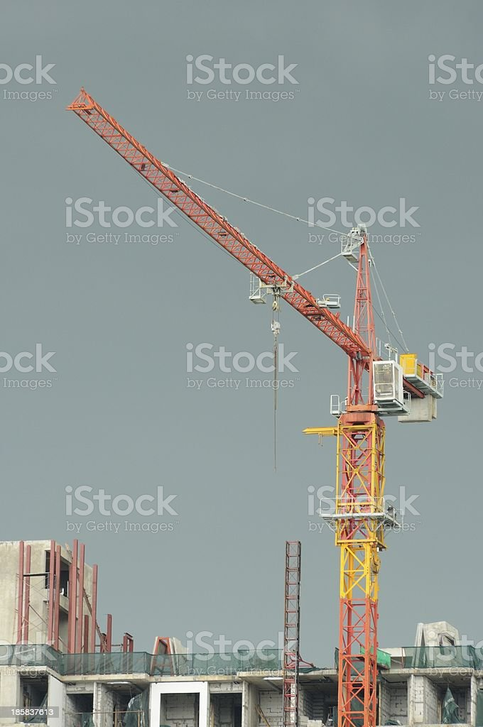 Construction Crane on top of building royalty-free stock photo