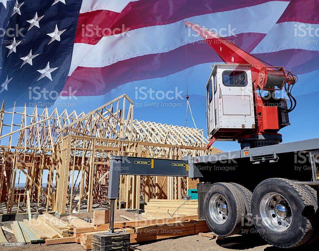 Construction crane setting house roof truss building America USA stock photo