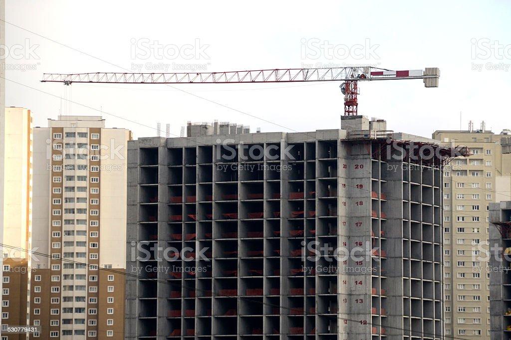 Construction crane towering above stock photo