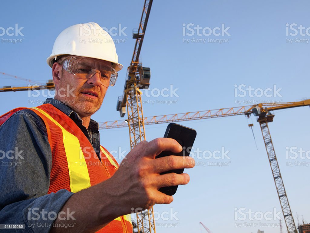 Construction Cranes and Engineer stock photo