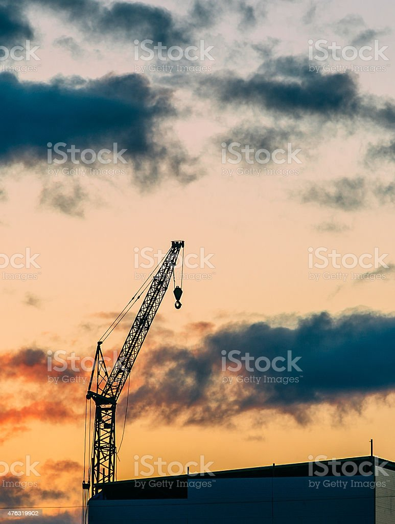 Construction cranes at sunset stock photo