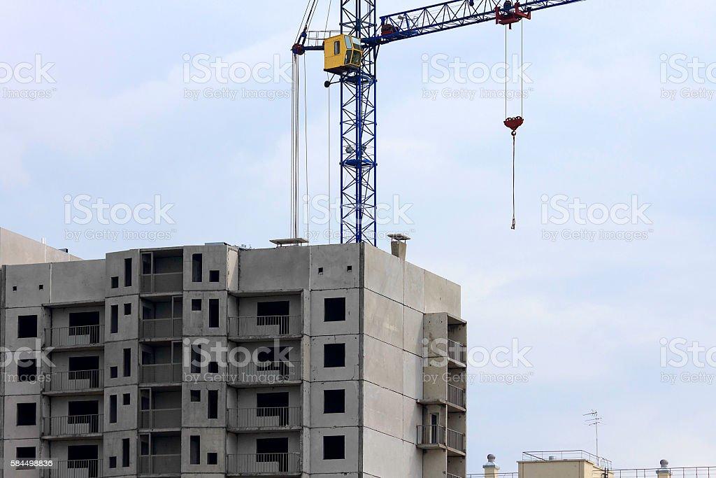 Construction cranes building a house stock photo