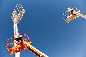 Construction Cranes equipment aerial boom man lifts in the sky