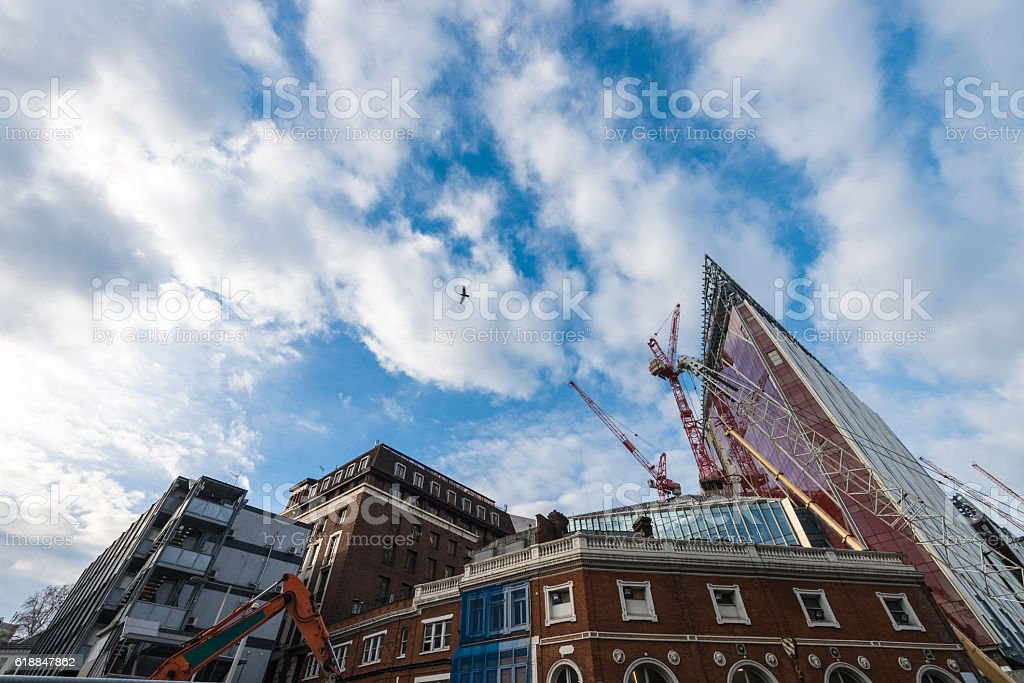Construction cranes in city of London, stock photo