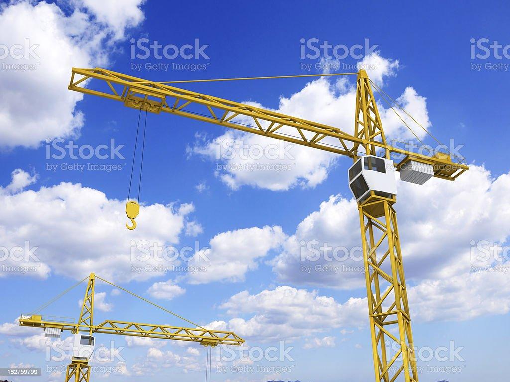 Construction cranes on sky background stock photo