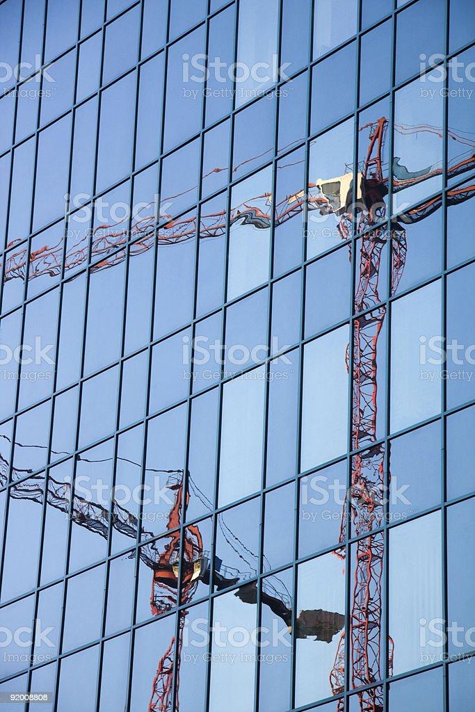 Construction cranes reflection stock photo