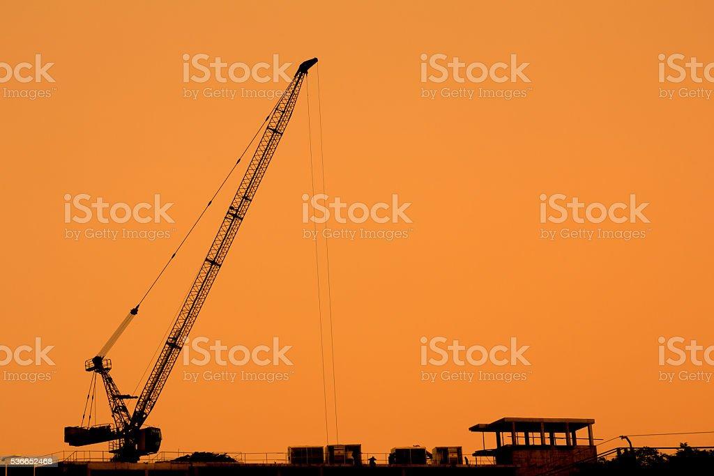 construction cranes silhouettes stock photo