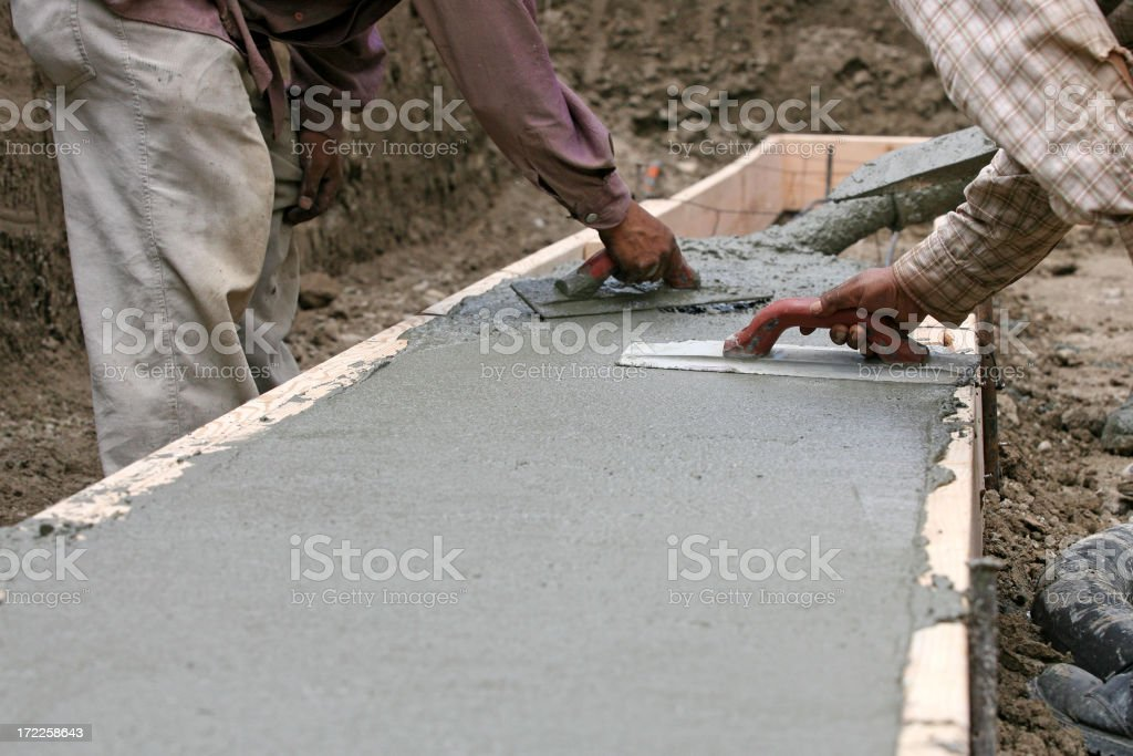 Construction crew laying cement royalty-free stock photo