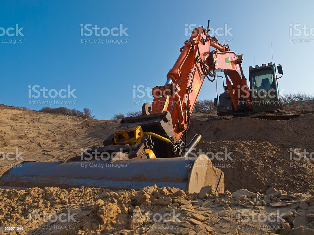 construction digger in a sandpit stock photo