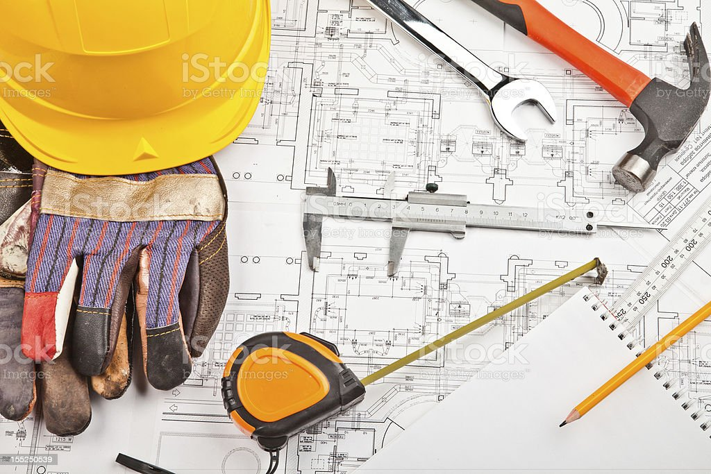 construction drafts and tools background royalty-free stock photo