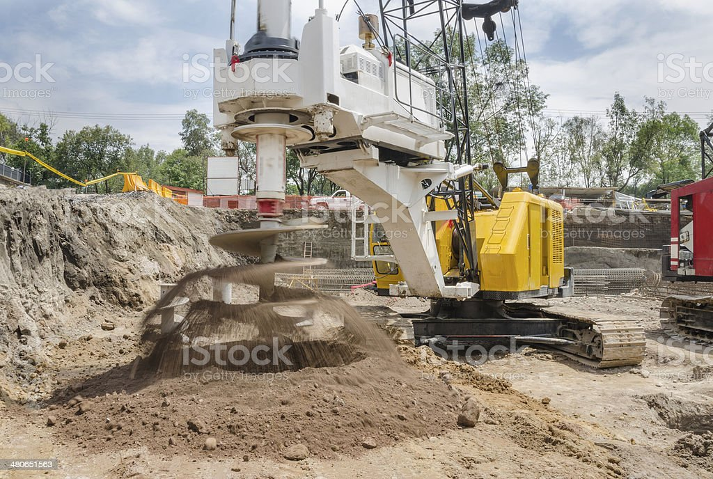 Construction drilling machine with dirt auger stock photo