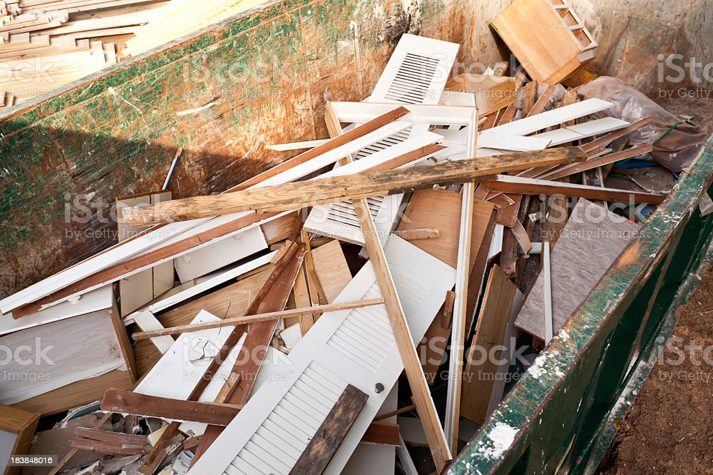 A construction dumpster collecting wood and other waste royalty-free stock photo