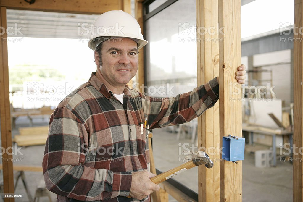 Construction Electrician Installing Box royalty-free stock photo
