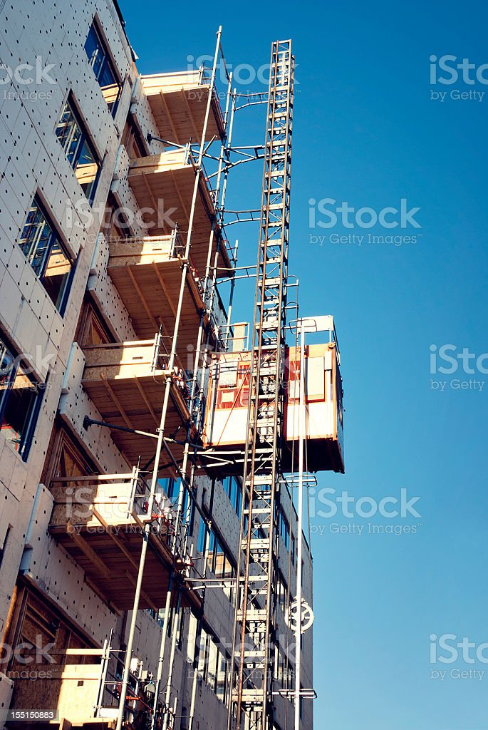 Construction Elevator and Scaffolds stock photo