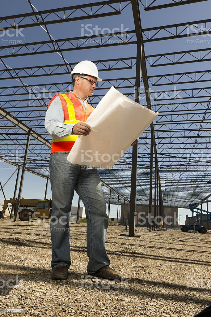 Construction Engineer and Blueprints royalty-free stock photo