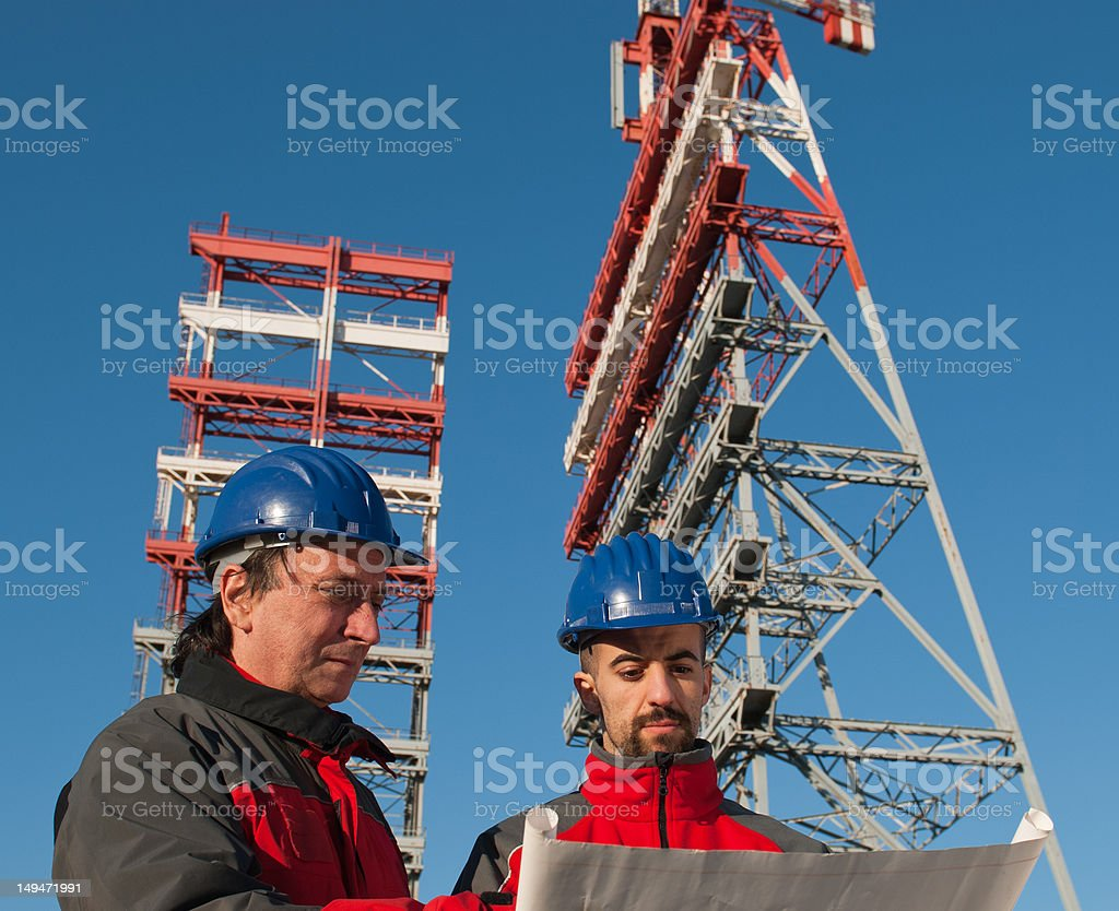 Construction engineer in front of edil cranes royalty-free stock photo