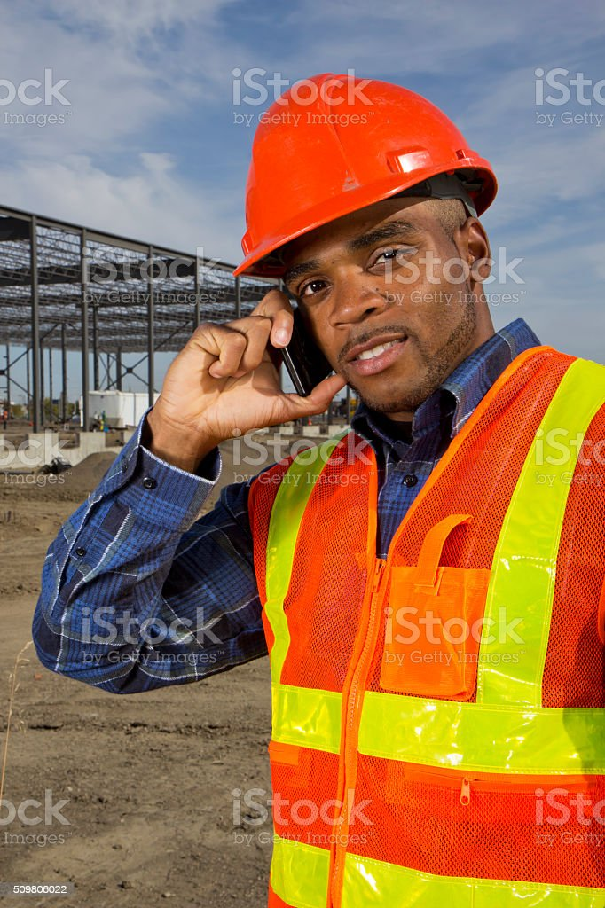 Construction Engineer, makeing a phone call at a Work site stock photo