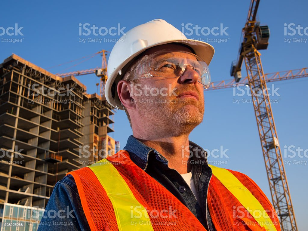 Construction Engineer or Architect and Cranes stock photo