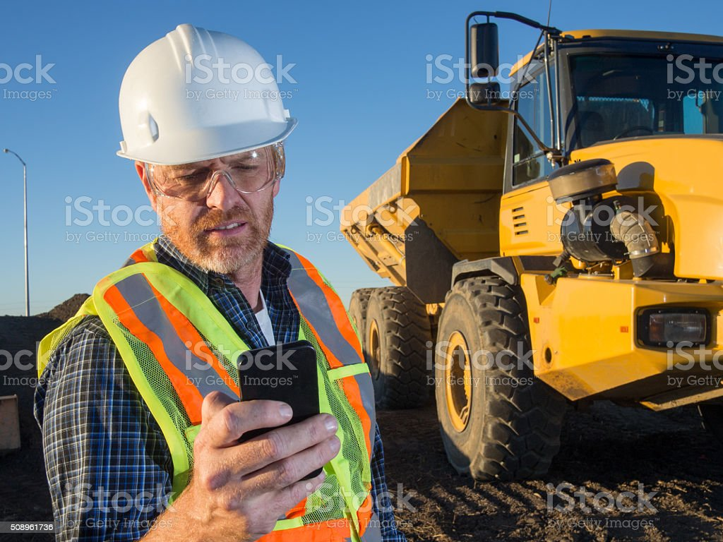 Construction Engineer, Truck and Smart Phone stock photo